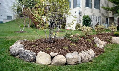... flat area in need of contours, berms and islands may be the solution.  Let us design and sculpt interest into your yard, using a variety  landscape ...